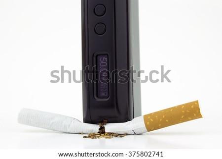 A box mod e-cigarette crushing a cigarette (close) - stock photo