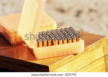 A box of shells at a cowboy shoot competition. - stock photo