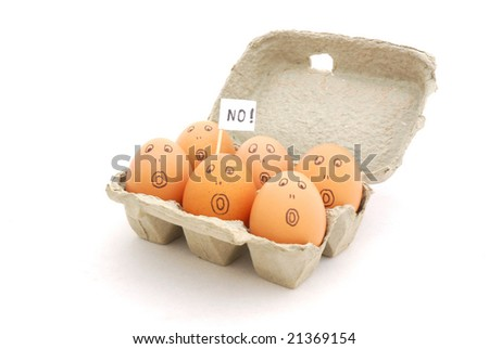 A box with six brown eggs with scared facial expression and sign (no!) isolated on white background - stock photo