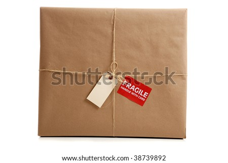 a Box wrapped in brown craft paper with a blank tag on a white background - stock photo