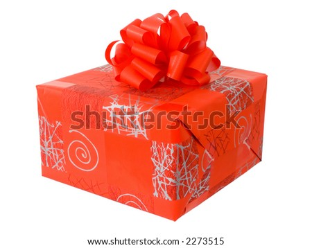 A boxed gift with red ribbon - stock photo