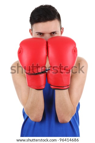 A boxer holding his gloves up to protect his face, isolated on white - stock photo