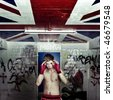 A boxer practising his blocks and rapid movement of evading hits in a graffiti clad suburban basement - stock photo
