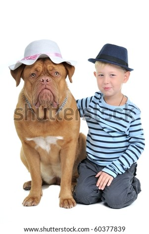 A boy and a dog both sitting in hats