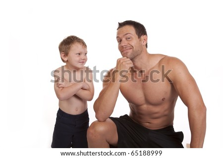 A boy and father feeling pretty good about their muscles.