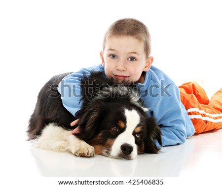 A boy and his dog in studio on white - stock photo