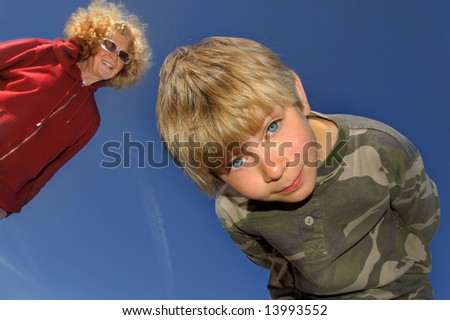 A Boy and his grandmother playing outside - stock photo