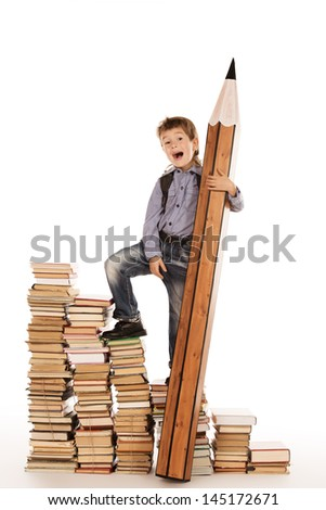 A boy climbing the stairs of books with a huge pencil. Education. Isolated over white. - stock photo