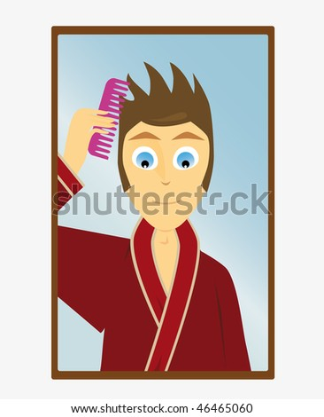 A boy combs his hair at the mirror - stock photo