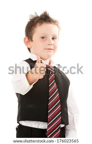 A boy dressed in dress slacks and vest giving the thumbs up symbol.