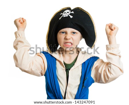A boy dressed up as a pirate pretending to be angry and dangerous. Isolated on white. - stock photo