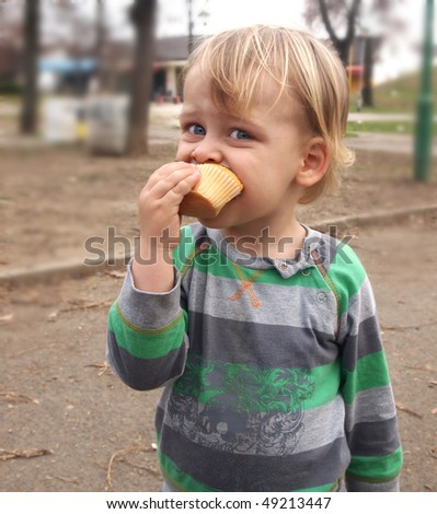 a boy eating muffin