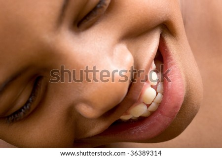 a boy enjoys a good laugh - stock photo