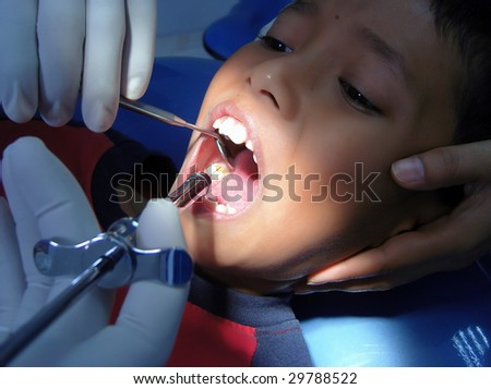 A boy expressions when the needle in his mouth - stock photo