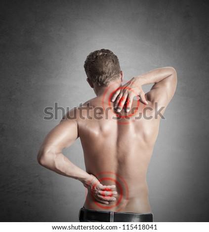 A boy felt back pain - stock photo