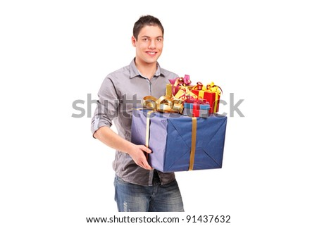 A boy holding a big gift isolated against white background