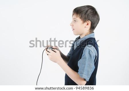 a boy holding a joystick - stock photo