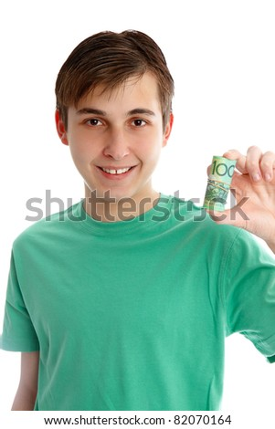 A boy holding a rolled up one hundred dollar bills.