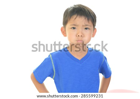 A boy in a bad mood - stock photo