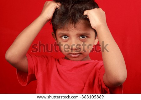 A boy in a depressed mood in a red background - stock photo