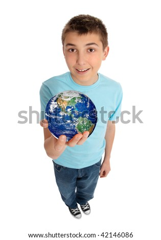 A boy in casual jeans and t-shirt holding with care our beautiful planet earth in his hand. - stock photo