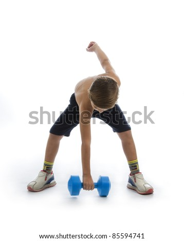 a boy in studio who raise a blue weight - stock photo