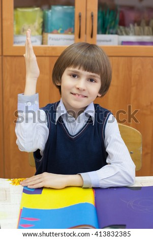 A boy in the class raised his hand - stock photo