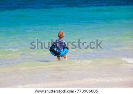 a boy in the sea at Koh Samet - Thailand
