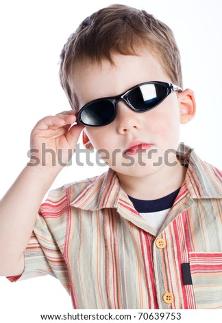 a boy in the sunglasses. isolated on a white background - stock photo