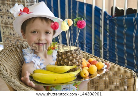 A boy is eating an apple - stock photo