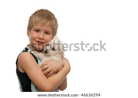A boy is holding a little white puppy; isolated on the white background