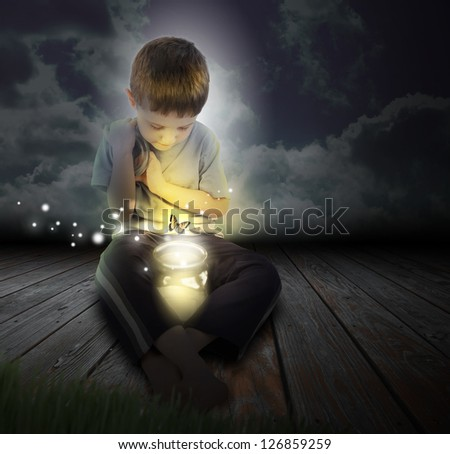 A boy is looking at a glowing bug firefly coming out of a jar with a butterfly at night for an imagination or hobby concept. - stock photo