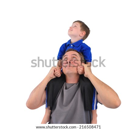 A boy is on his father's shoulder on a piggy back ride and the people are looking up at a blank white isolated background. - stock photo