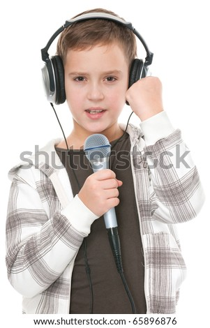 A boy is singing, holding a microphone and wearing headphones; isolated on the white background - stock photo