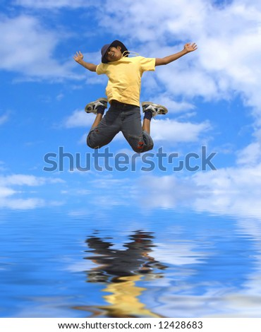 a boy jumping with joy - stock photo