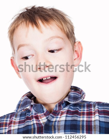 A boy looking down - stock photo