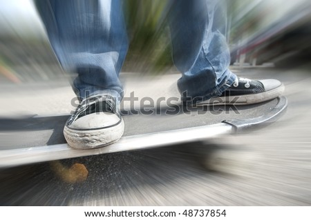 a boy on skateboard close up of foot