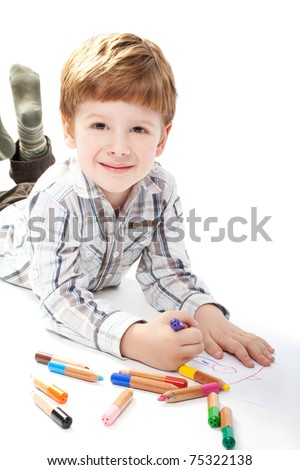A boy painting on a white paper isolated on white background