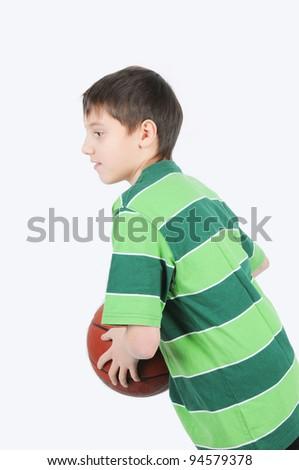 A boy playing basketball - stock photo