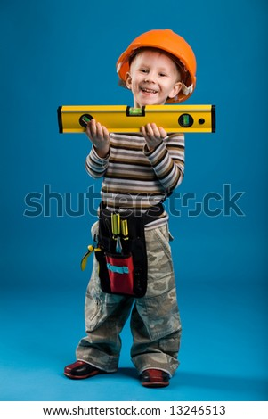 A boy playing construction worker, isolated - stock photo