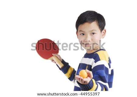 A boy playing table tennis - stock photo