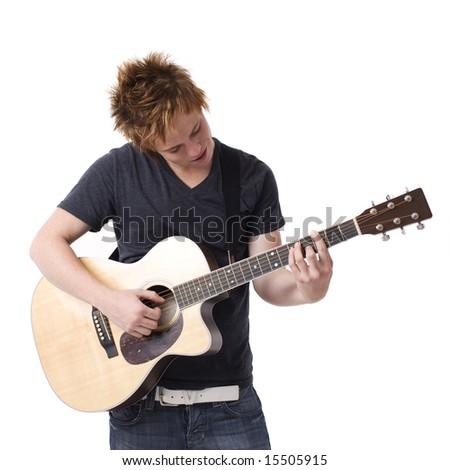 A boy plays his guitar - stock photo