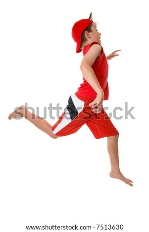 A boy running or sprinting with large open strides in a hurry  or just energetic, Some motion in  fingers. - stock photo