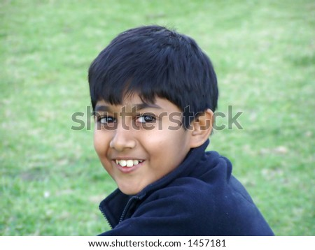 a boy smiling - stock photo