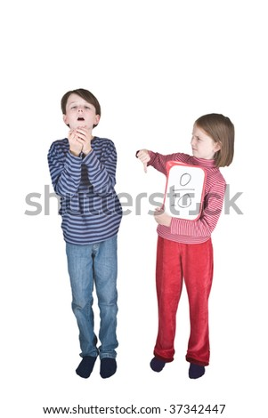 A boy sneezes into his hands, and a girl makes a thumbs down sign because this is one of the ways that swine flu is spread. She is holding a tablet on which is written a score of 0 out of 10. - stock photo