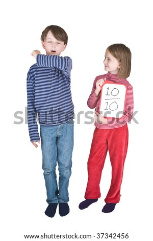 A boy sneezes or coughs into his elbow, and a girl makes a thumbs up sign - its one of the ways to prevent the spread of swine flu. She is holding a tablet on which is written a score of 10 out of 10. - stock photo
