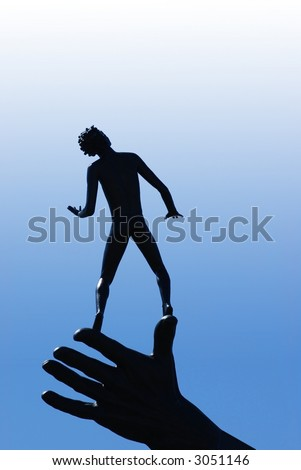 A boy standing on a hand and looking up at the bright sky - stock photo