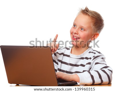 a boy surfing on laptop and has a idea - stock photo