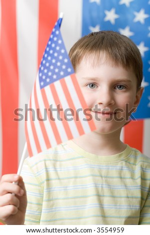 A boy waving with american flag, vertical