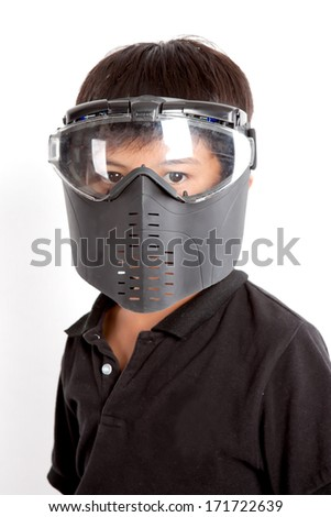 A boy wearing a paintball mask